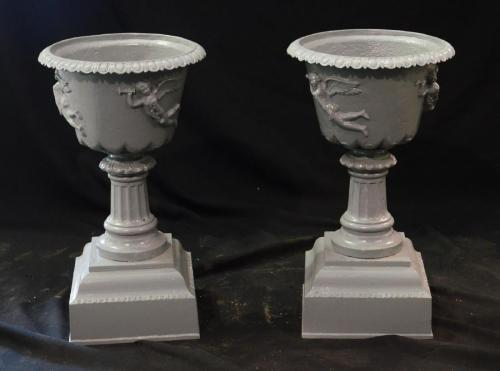 Cast Iron pair of Figural urns