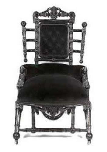 Victorian Hunzinger Chair With Carved Heads SOLD